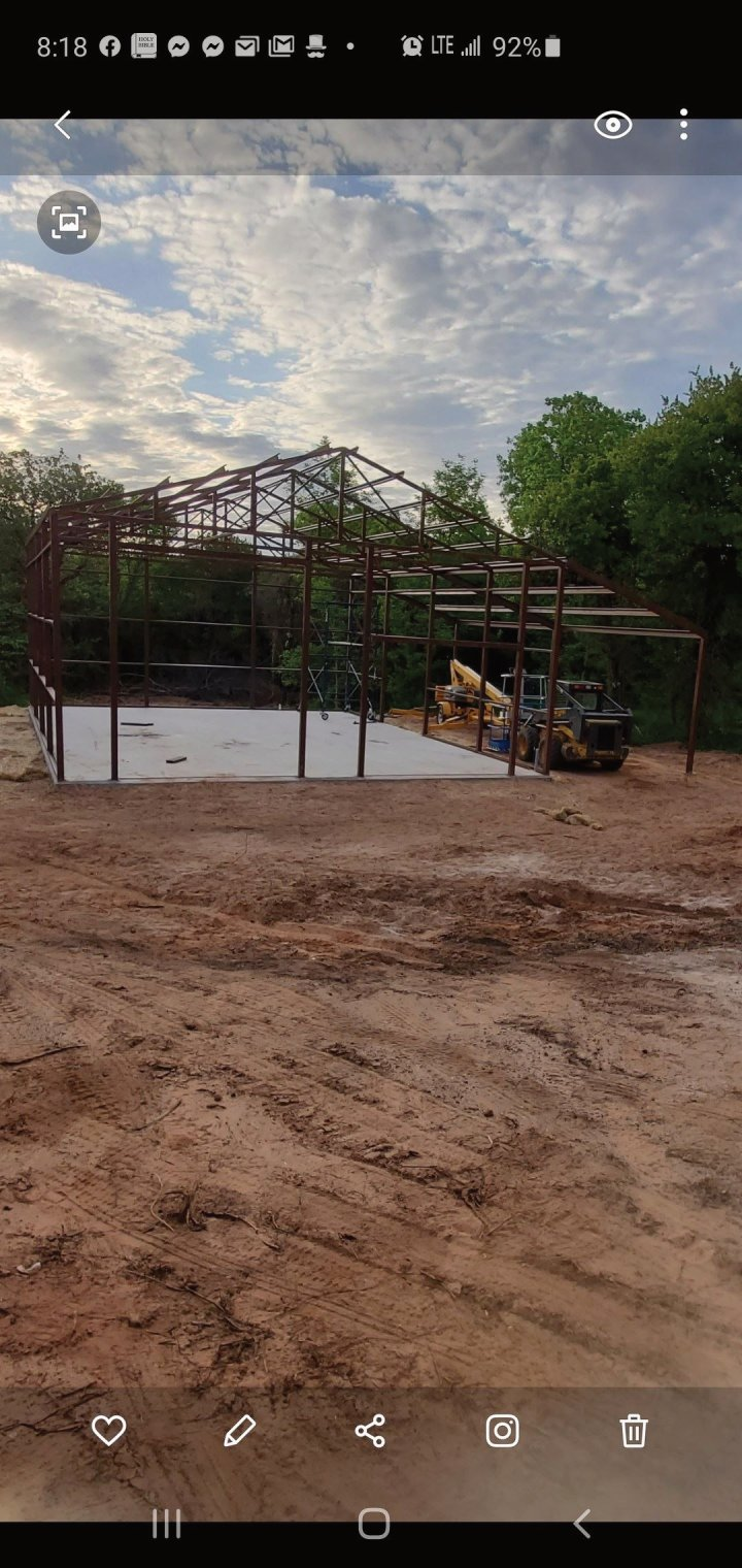 Dirt work, concrete, and steel building