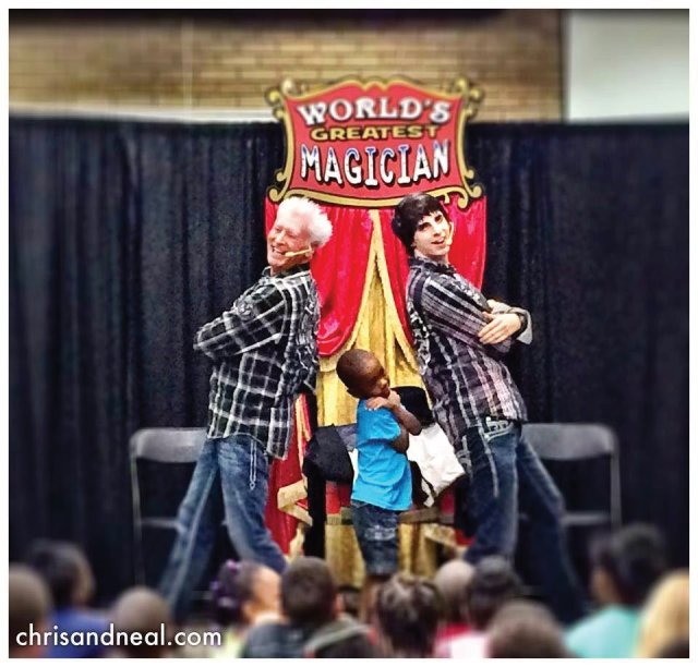 Magicians Chris and Neal in Raleigh, North Carolina posed with a child after their levitating act