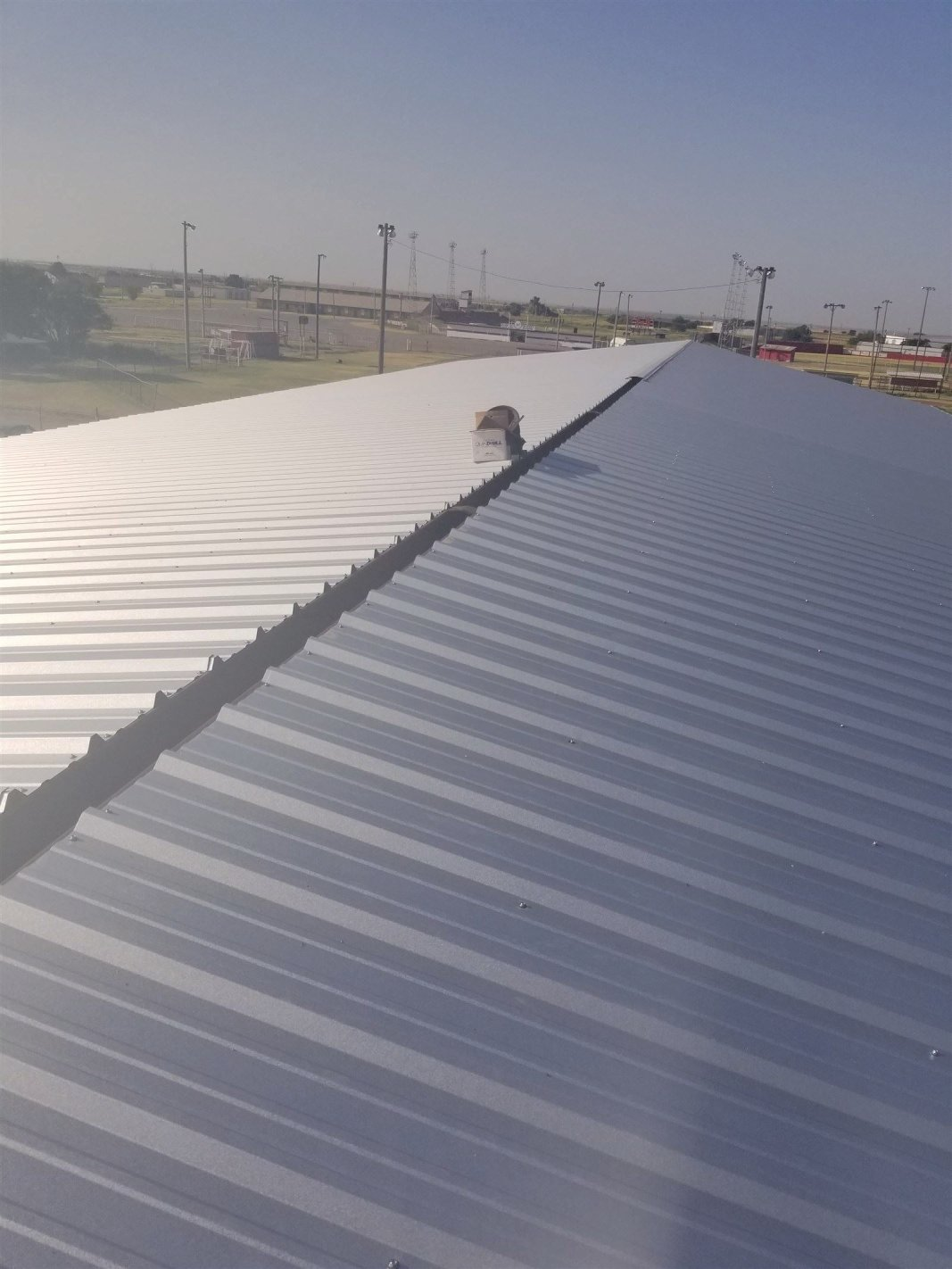 : Metal sheeting roof getting completed