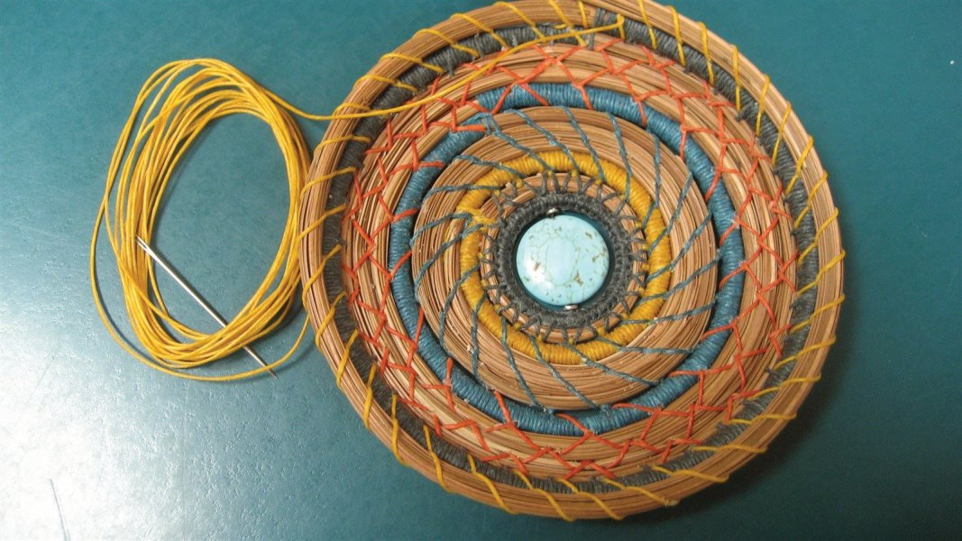 Artistic creative and colorful pine needle basket, with turquoise stone