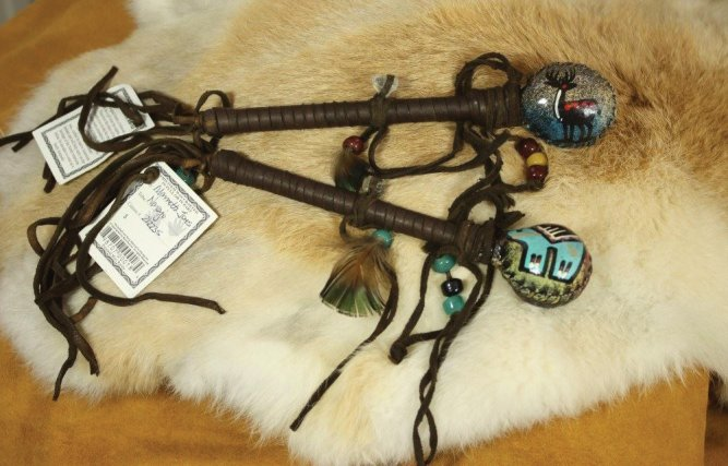 Rattle Sticks with Hand Painted Hide and buckskin wrapped Quartz Crystals on the handles. Lovely Navajo Made with Artists Certificate attached.