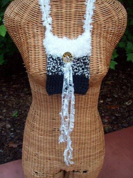 A Defining Moment : Novelty yarns and fringe completes the youniqueness of this piece  $30.00