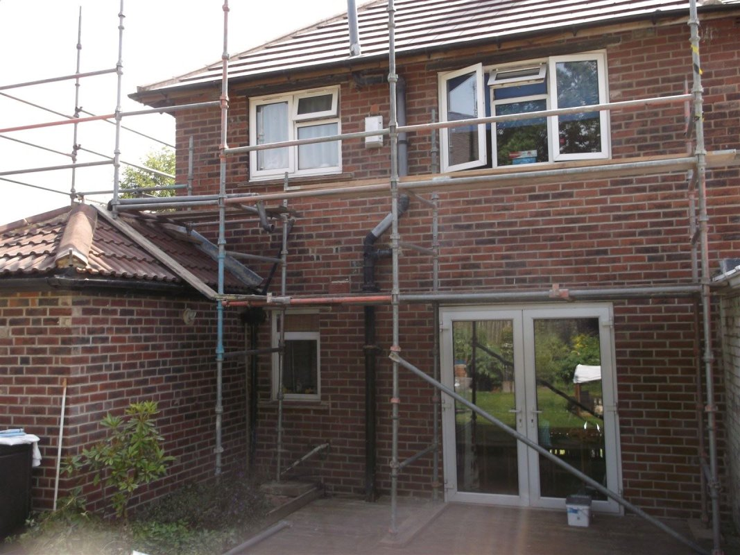 repointing a brick of a brick house in pudsey