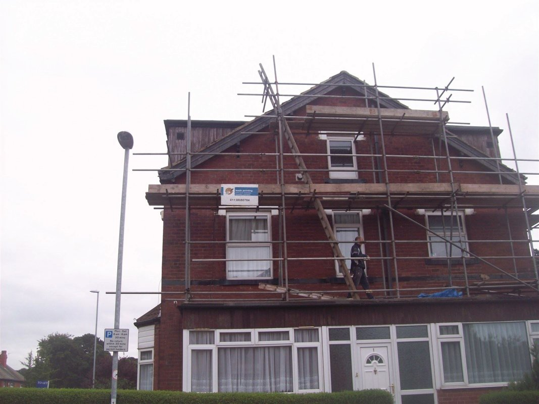 leeds pointing carrying out maintenance work the painting of facia and soffits