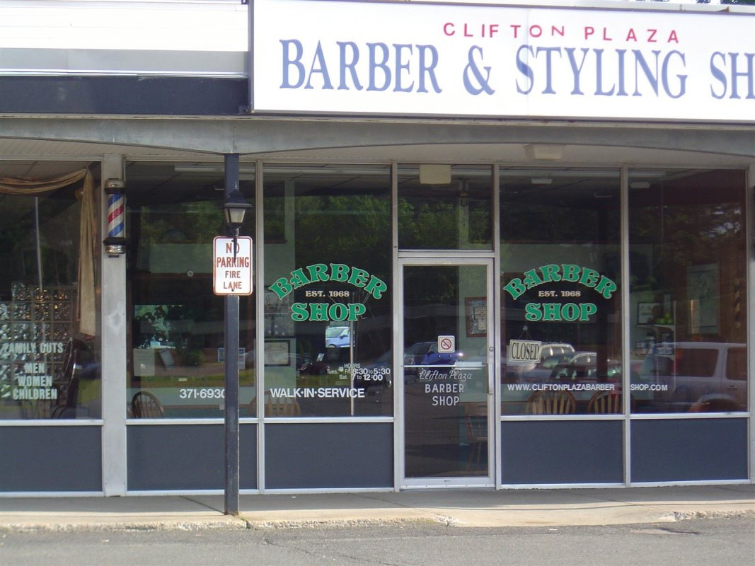 : store front with new window signs