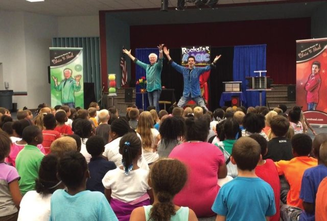 Magicians in Raleigh North Carolina performing incredible illusions to a captive crowd of energized children ready to be amazed by dynamic magic and illusions at their Rockingham library outside of Raleigh North Carolina