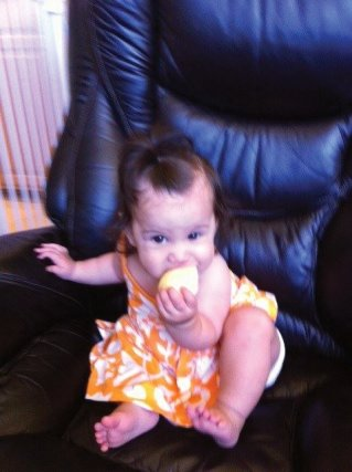 Bradley baby gnawing on an apple