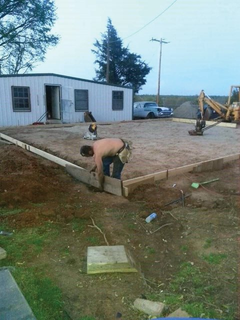 : setting forms getting ready to pour concrete