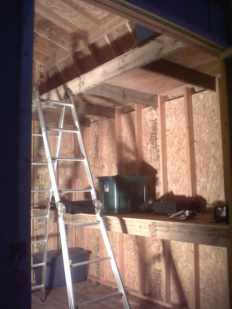 Heavy duty loft and work bench built in
