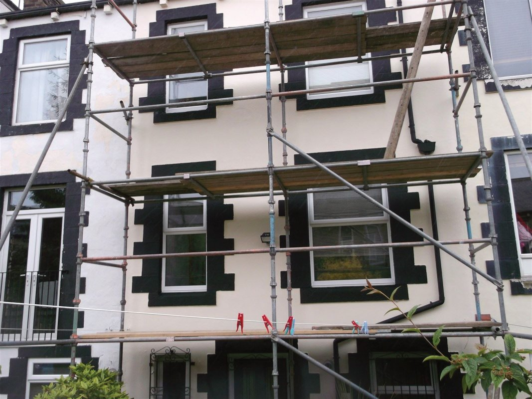 once all prep work was carried out we repainted all the render in magnolia and the features in black   all work carried out by leeds pointing 01138080784