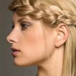 An easy way to disguise growing out a fringe is by braiding it across your face into your hair.