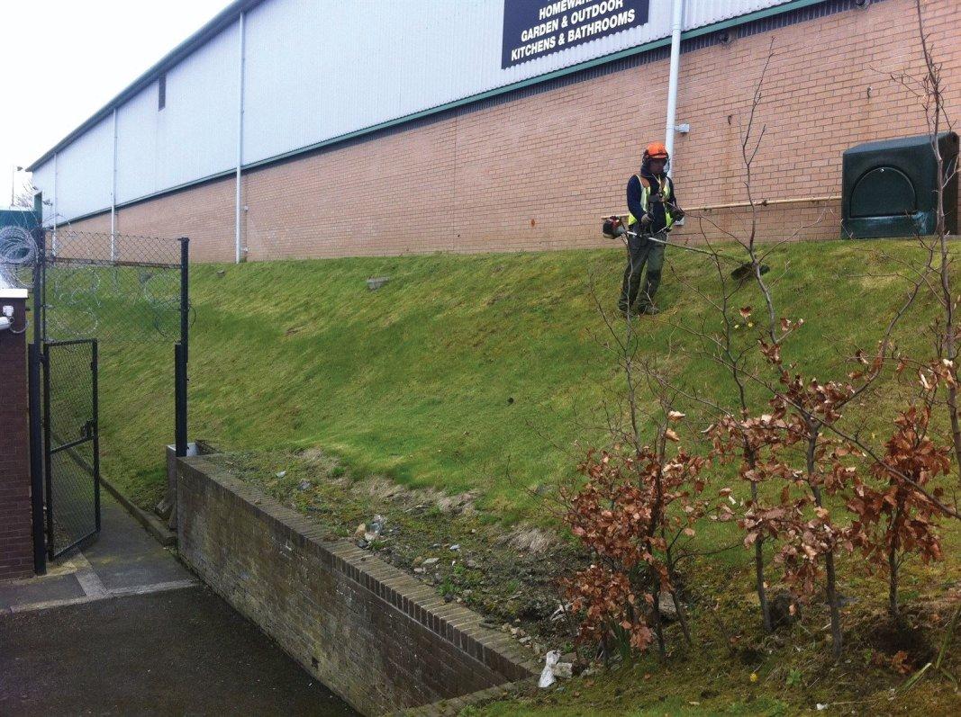 Steep embankment grass cutting in Edinburgh, Midlothian, East Lothian, Fife and the Scottish Borders regions