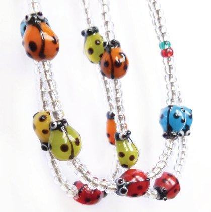 Glass lady bird necklace