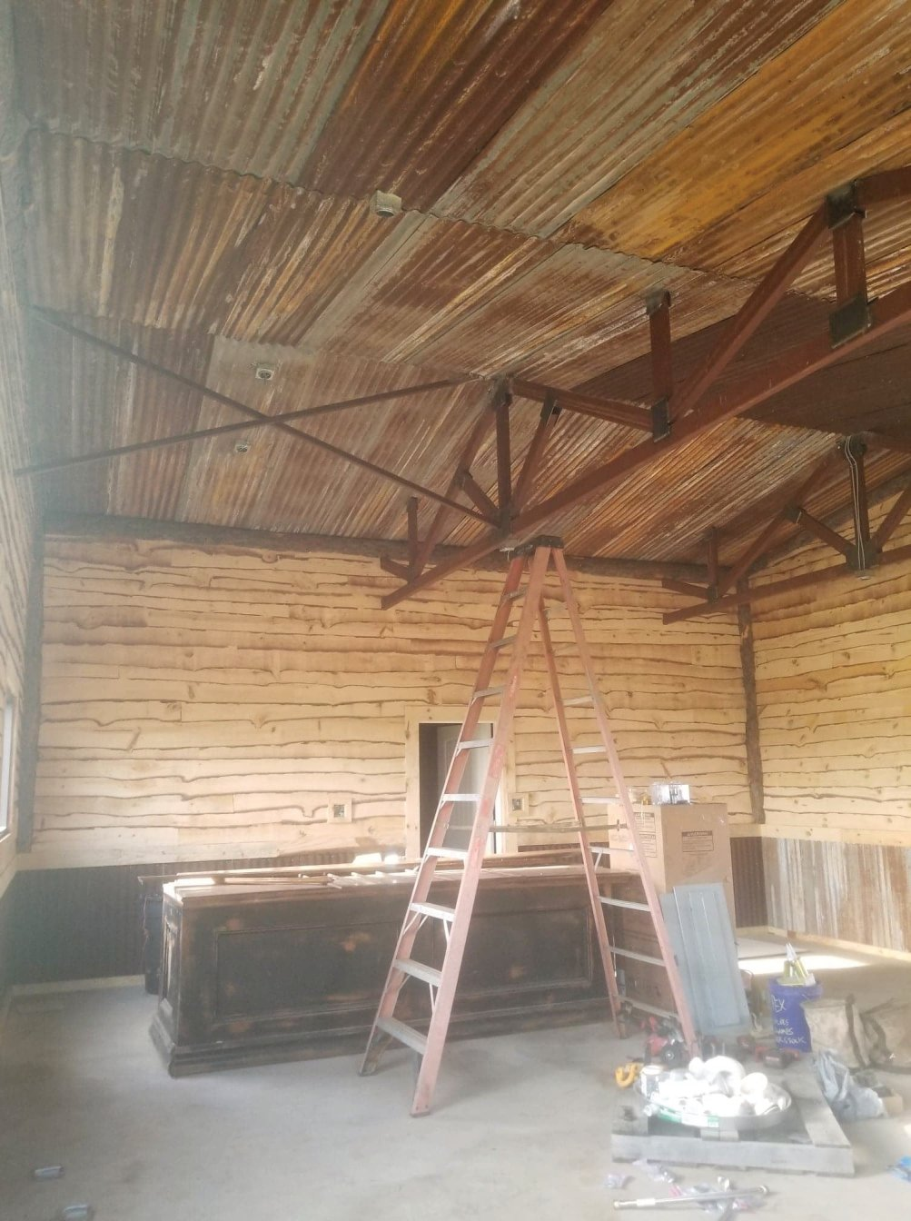 : Custom rustic barn feel inside is what they asked for, so that is what they got!