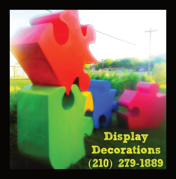 parade float large puzzle displays for autism walk event in Texas by The Cascaron Store