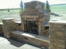 Wood burning fireplace with log storage. 4'' thick stone mantle