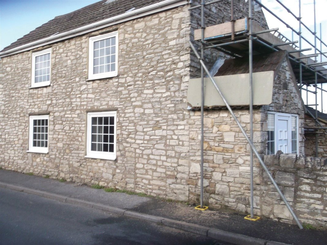 stone cottage showing the old mortar before leeds pointing removed  01138080784