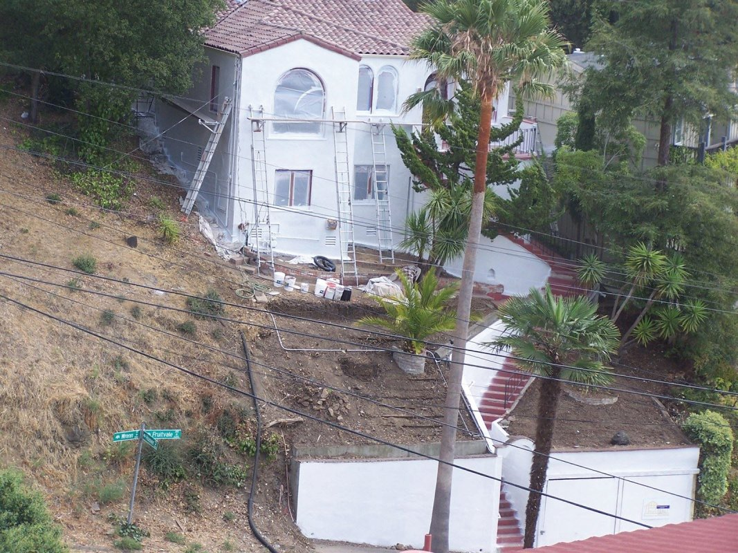 This is an illustration of the body of a house in Oakland, CA that after preparation, priming, and application of 2 coats of an elastomeric waterproof coating before painting. The stucco on this house had several cracks, failing paint, and dry rot problems due to water penetration. I painted this house 5 years ago and it still looks great.