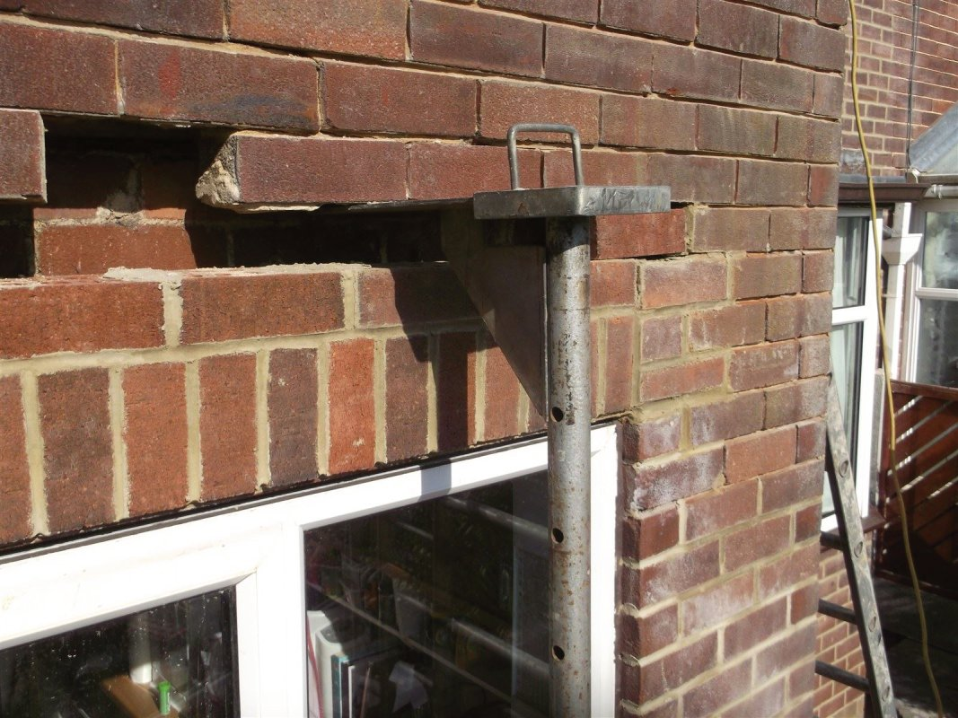 angle iron in place  and new brick work been walled into place