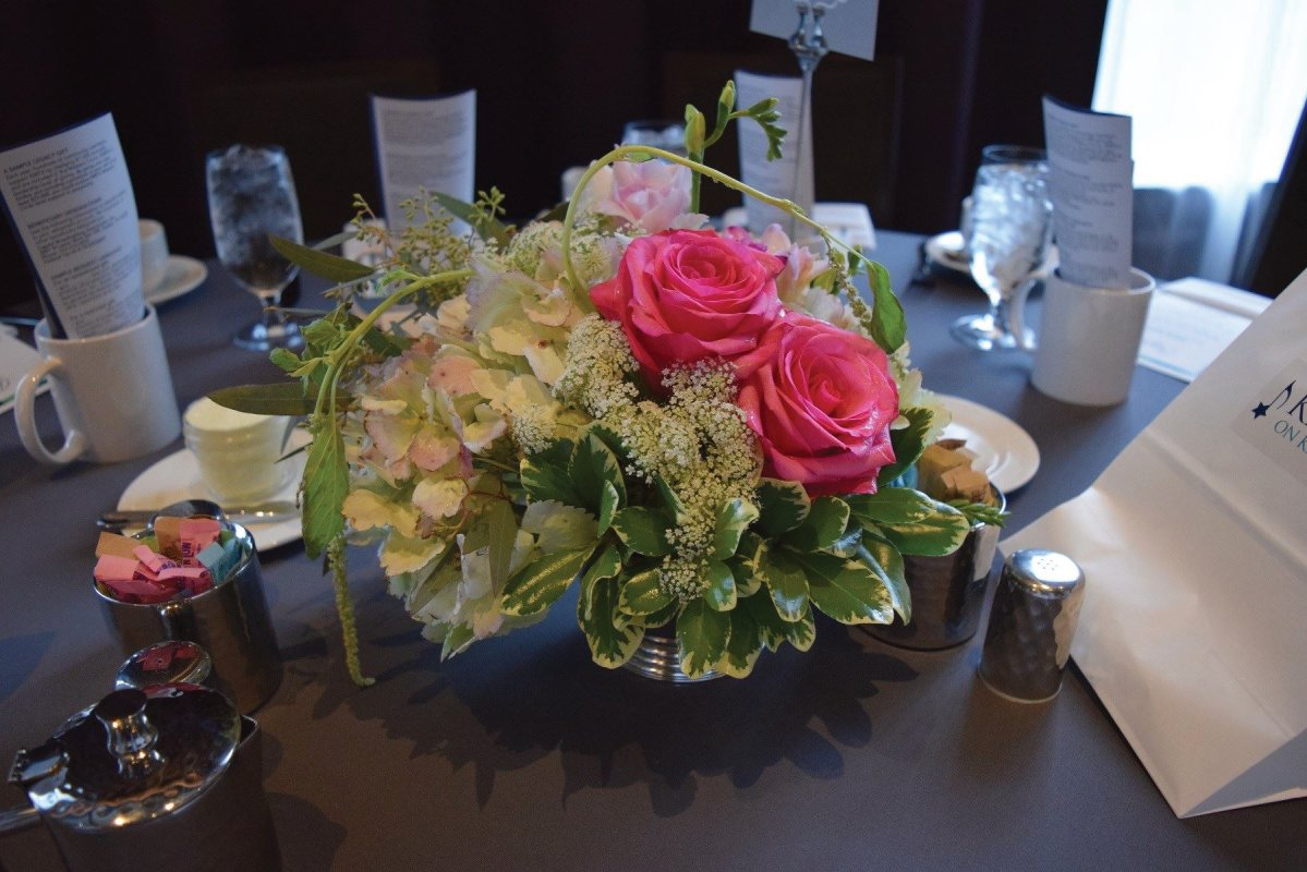 : ... Hydrangea, Queen Anne's Lace, roses, and hanging amaranthus were among the blooms in these silver Revere Bowls.  Members of the KMFA Board were given these centerpieces as gifts to take home after the brunch.