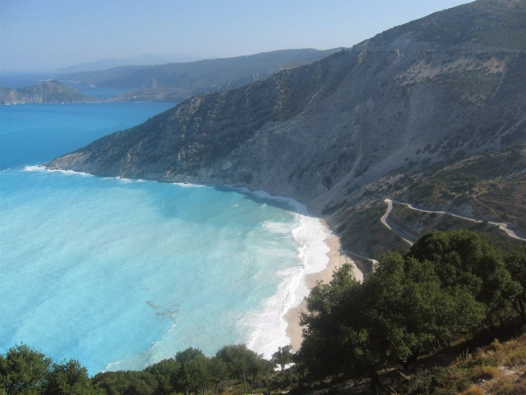 Myrtos Beach, Kefalonia Greece is one of the best beaches with a beautiful sunset.