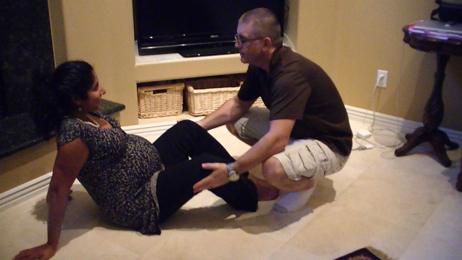 The Butterfly : Coaches can help by adding resistance only as mom stretches her legs open.