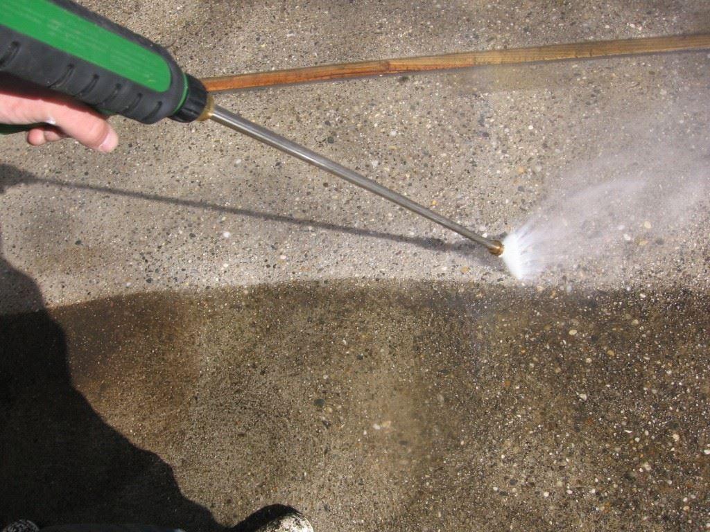 Pressure washing a concrete patio