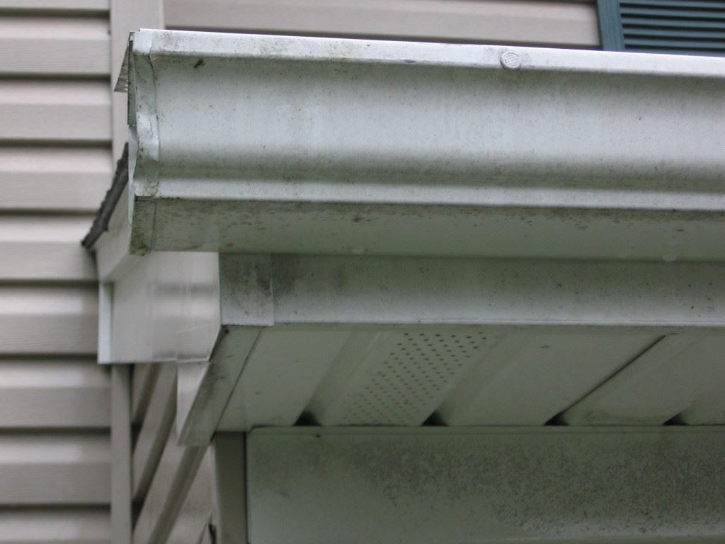 Stained gutters : power washing alone won't remove the stains