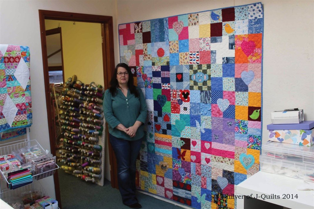 Me with the completed quilt in my studio