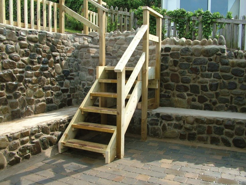 wooden steps and stone walls new quay ceredigion west wales