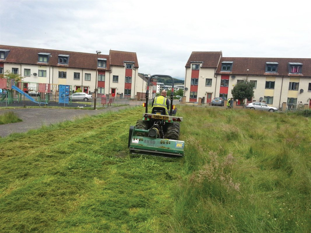Housing estate open play area requiring flail cutting. Large overgrown grass areas are dealt with with our tractor and flail machine. This machine is ideal for virtually any overgrown grass area, paddocks, wild meadow clearance and general land clearing operations. Edinburgh, Midlothian, East Lothian, Fife and the Scottish Border regions