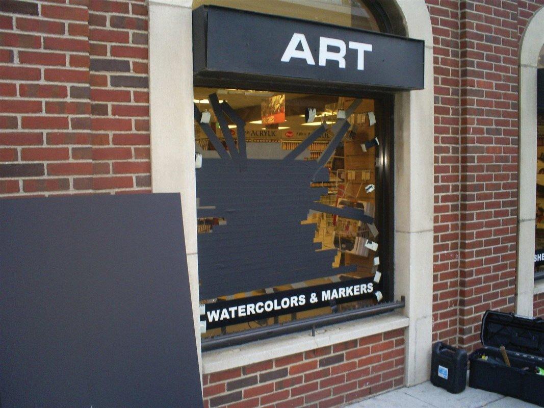 broken plate glass window on South Broad Street in Philadelphia Pa