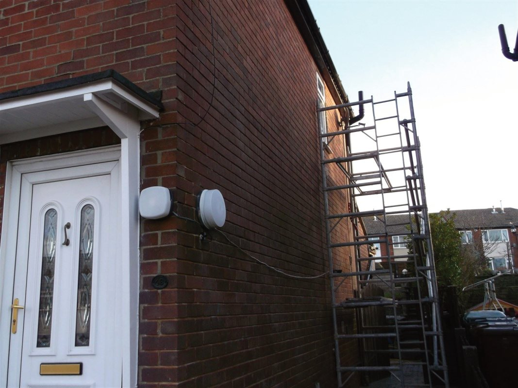 the cutting rakeing out of the old mortar joints before repointing the brickwork with new mortar