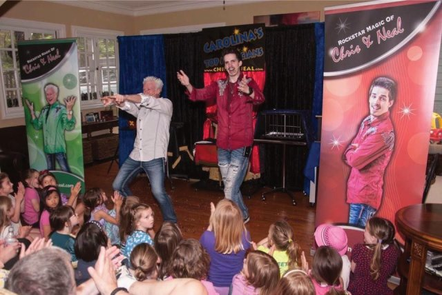 Chris and Neal are family magicians working the crowd of children and parents in Wake Forest, North Carolina