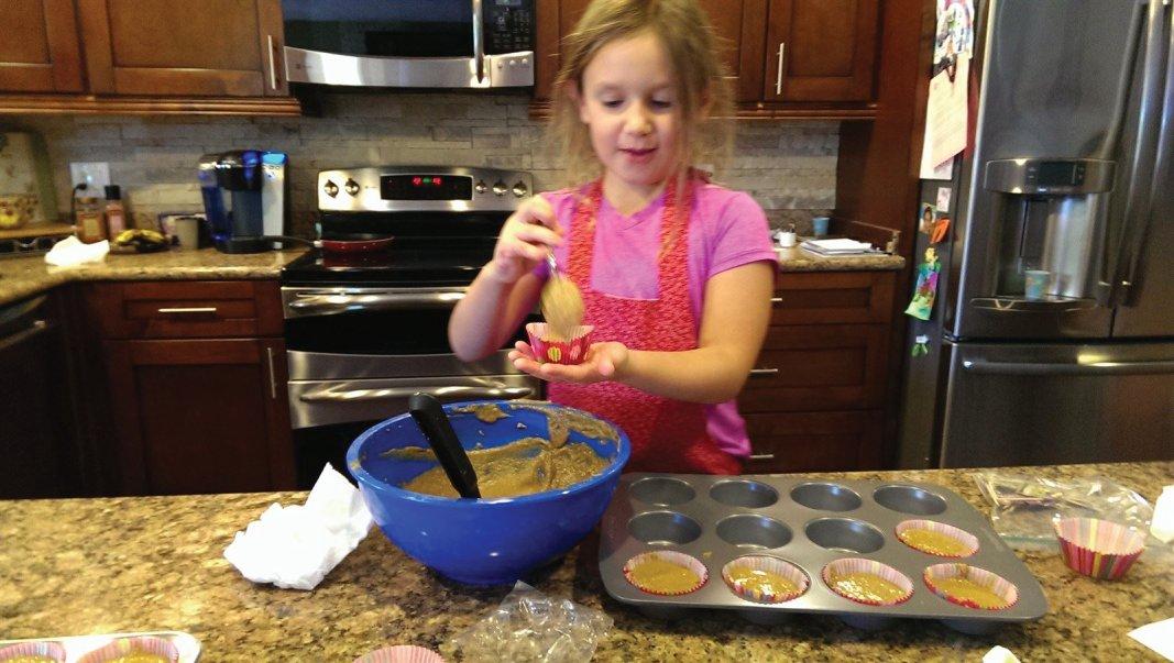 Filling cupcake holders.