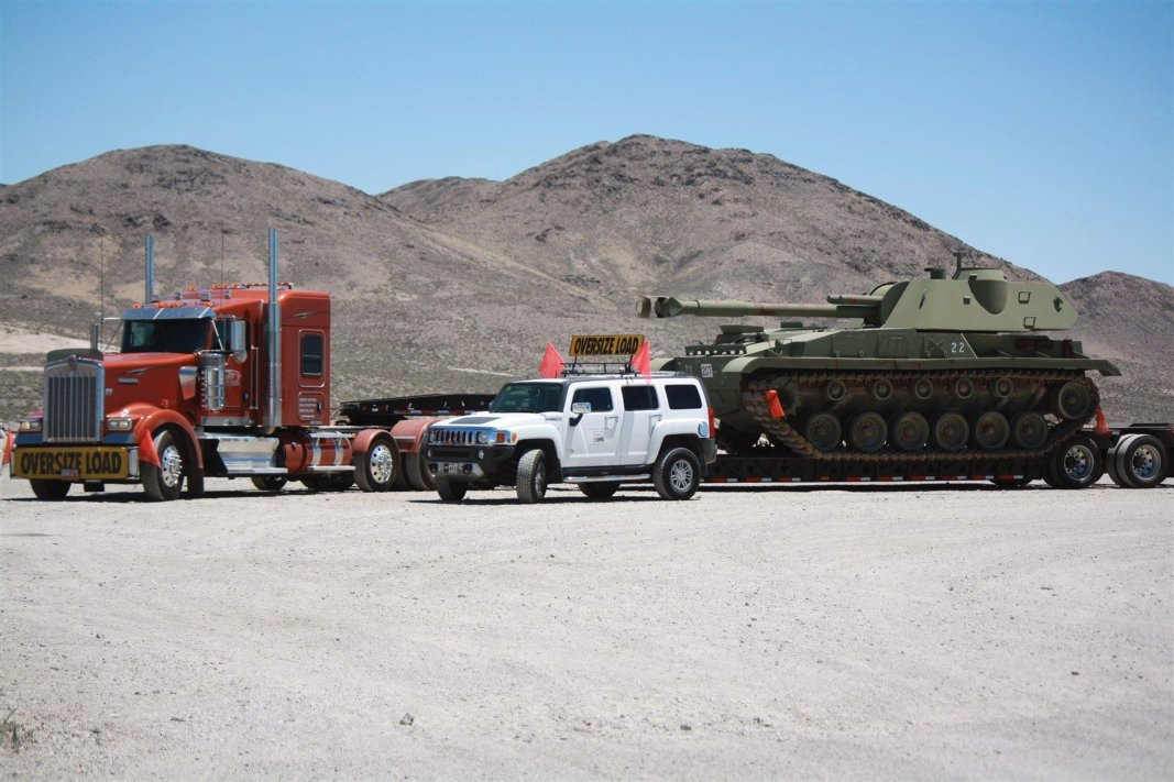 A ROADRUNNER PILOT CAR ESCORT FOR MILITARY EQUIPMENT MOVERS