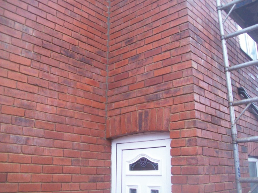 cut raked out brickwork and mortar stain remover used to clean the brick work