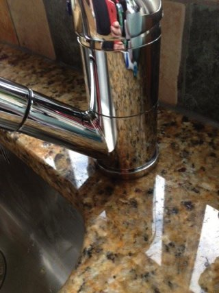 Limescale, water mark removal on granite worksurfaces. Legacy Deep Cleaning after